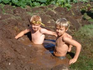 Boys in a mud bath